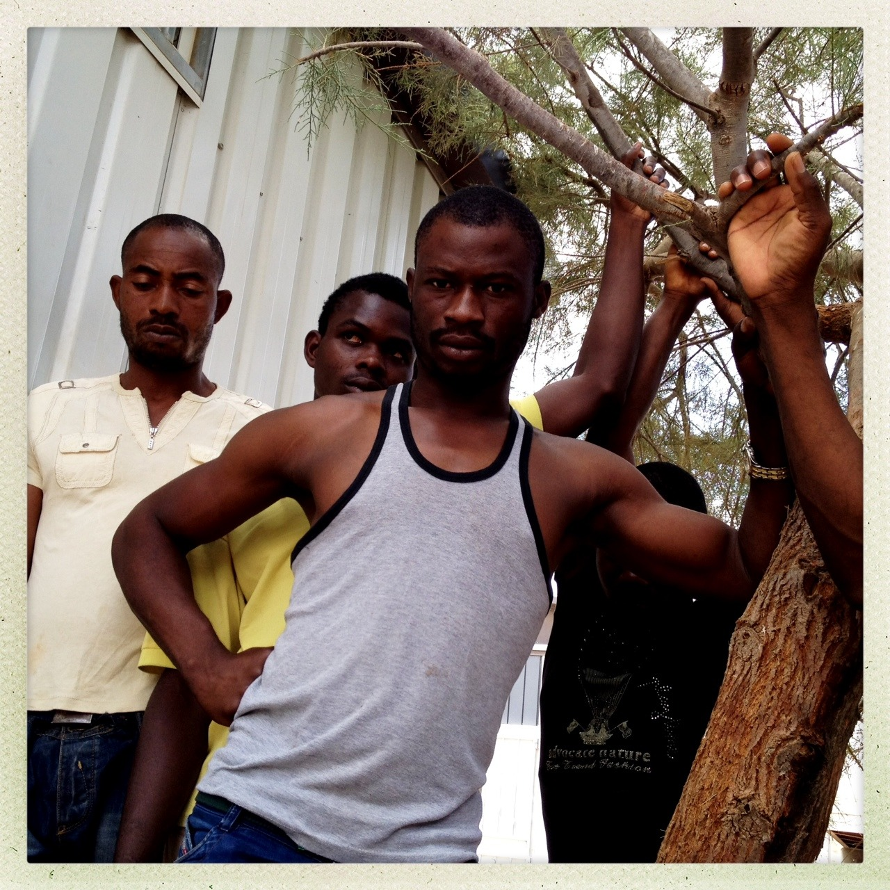 Gharyan, Libya | July 23, 2012  Illegal migrants from Nigeria, held at a Libyan detention center, wait to be processed and receive travel papers, enabling them to be repatriated via a UN chartered plane. Libyan authorities have been increasingly hostile to African migrants and the threat of deportation includes transportation via a truck through the blisteringly hot Sahara desert. (Photo by Benjamin Lowy/Getty Reportage) Conflict photographer Ben Lowy, on a grant from the Magnum Foundation's Emergency Fund, is shooting from Libya on the first-ever photojournalism inspired Hipstamatic lens — and posting exclusively to Tumblr. Check out Lowy's Tumblr and Storyboard for more. Also see Storyboard's interview with the photographer.