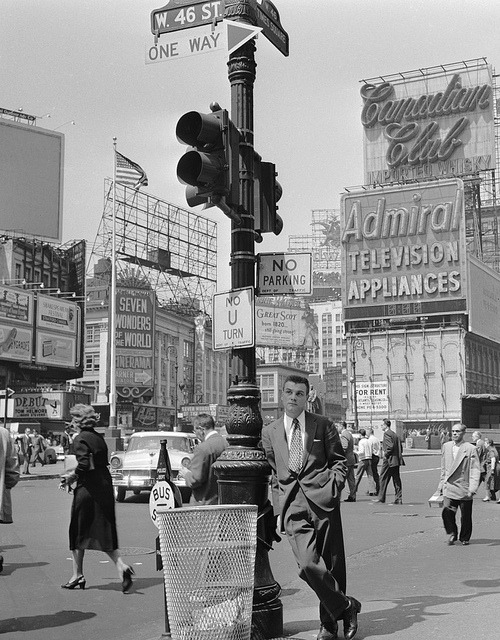 fuckyeahvintage-retro:  A pedestrian bides his time in Times Square, NYC (1956)