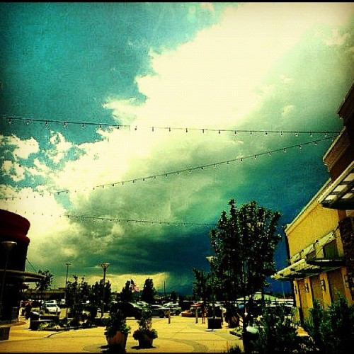#outside #outdoors #mall #storm #sky #blue #cloud #rain #building #tcby #ominous #mountains #landscape #cityscape (Taken with Instagram)