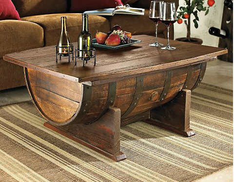 jonathancorley:  whiskey barrel coffee table. 100 Proof.  Once a fixture in a Tennessee distillery, now an extraordinary furniture piece for your home. This repurposed aged-oak Whiskey barrel features a spacious tabletop, hinged to reveal a generous storage area. Includes original barrel, pine tabletop and base hand-stained for rustic charm.