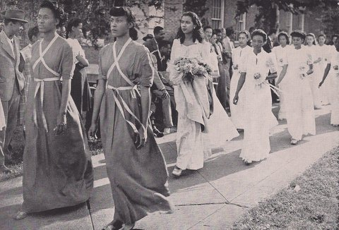 "Carolyn Polk, ""May Day Queen"" of 1946 with her court as they appeared in the October 1946 edition of the Howard University Bulletin. According to the bulletin, May Day celebrations, staged by the Physical Department for women, were a ""gigantic and beautiful spectacle in which students give exhibitions in dancing, singing and calisthenics."" The highlight was the crowning of the May Queen who reigned over the festivities with an alumnus serving as ""Alma Mater."" The parade of beautifully gown women was proudly described in the bulletin as a ""traditional march of beauty, movement and music."""