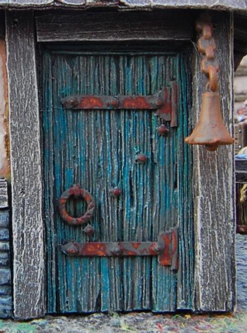 The door of the fishmongers' shop. You can see how old and worn out the building is.