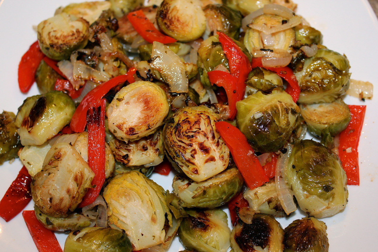 what-vegans-eat:  roasted brussels sprouts with peppers and onions