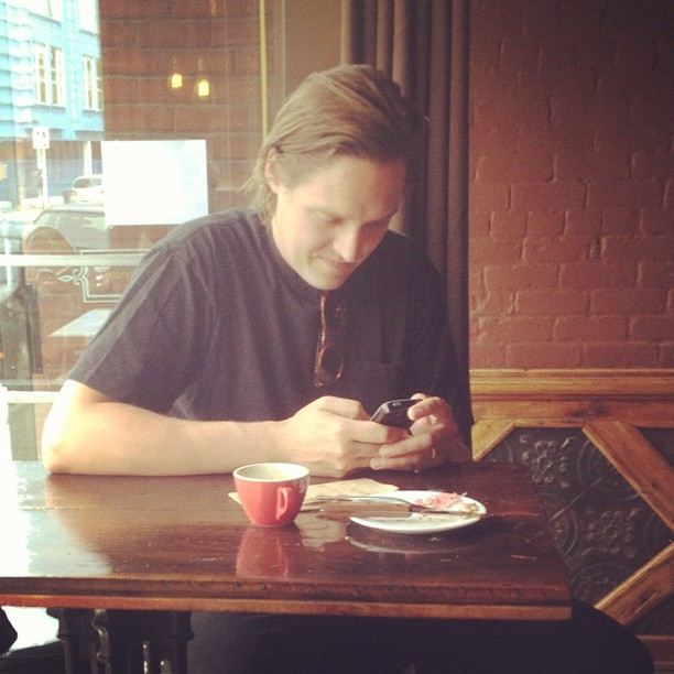 catsinchurch:  Coffee with Win Butler of Arcade Fire NBD (Taken with Instagram at Café Sardine)  Made me start laughing uncontrollably at my desk.