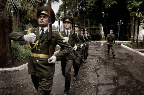fotojournalismus:   Abkhaz troops in Sukhumi. Abkhazia's defense minister, General Major Mirab Kishmaria, said he and other Abkhaz officers spilled blood to win their independence.  20 years after Abkhazia declared independence from Georgia, TIME contract photographer Yuri Kozyrev returned to the region to document the place where he vacationed as a boy and later photographed a brutal war. See more photos here.(via timelightbox)