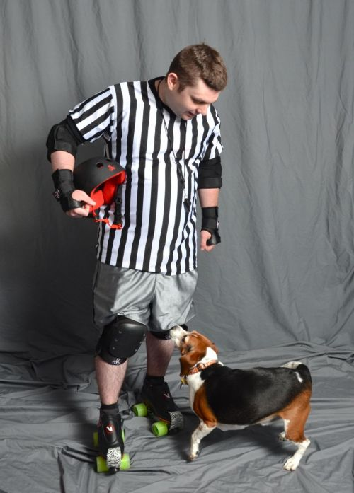 "thingsyoudonthearatderbypractice:  Baxter the Beagle says ""Excuse me Zebra, are there cookies in your knee pads?""  OM NOM NOM knee pads >__<"
