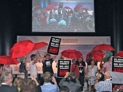 "Sex workers and their allies staged a protest at a 4 pm press conference held on the opening day of the International AIDS Conference. More than 20 protesters rushed to the stage during the press conference chanting, ""No drug users, no sex workers, no I… A… C…"" Many sex workers and drug users have been unable to enter the United States due to immigration restrictions on anyone who may have used drugs or engaged in sex work."