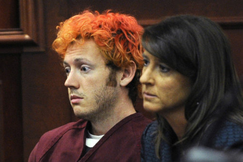 Colorado theater shooting suspect James Holmes appears dazed in courtJames Holmes, the suspect in the Colorado theater massacre, appeared in a Colorado courtroom on Monday, three days after one of the deadliest shooting sprees in modern American history.Arapahoe County District Court Judge William B. Sylvester advised Holmes of his Miranda rights, and said that there was probable cause to continue to hold him without bond on suspicion of first-degree murder.Holmes, who was transported from a holding cell to the courtroom via an underground tunnel, appeared dazed. His brow furrowed. His head bobbed. His eyes opened and closed often. His hair was dyed red. His hands and feet were shackled. He did not speak.Seated in a jury box next to Tamara Brady, a public defender, Holmes never looked in the direction of a gallery that included about two dozen victims and their advocates. Two sheriff's deputies stood watch nearby.The preliminary hearing lasted about 11 minutes. Holmes' next court appearance is July 30, when he is expected to be charged.Photo Credit: (Pool/AP)