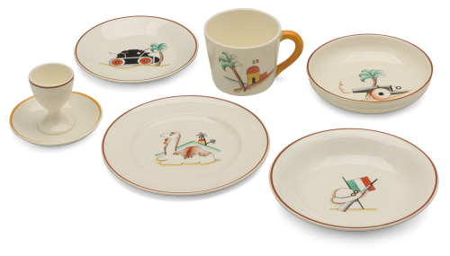 Figli della Lupa (Sons of the Wolf) tableware set. 1930s Outside the classroom, Italian children could eat and drink from tableware designed to whet their appetites for future service in the colonies. In the mid-1930s the Richard Ginori porcelain factory manufactured children's plates, cups, and saucers decorated with stereotypical colonial imagery—the ubiquitous palm tree, camel, pith helmet, rifle, tank, and huts flying the Italian flag—that celebrated Italy's conquests in North and East Africa. Learn more at MoMA.org/centuryofthechild