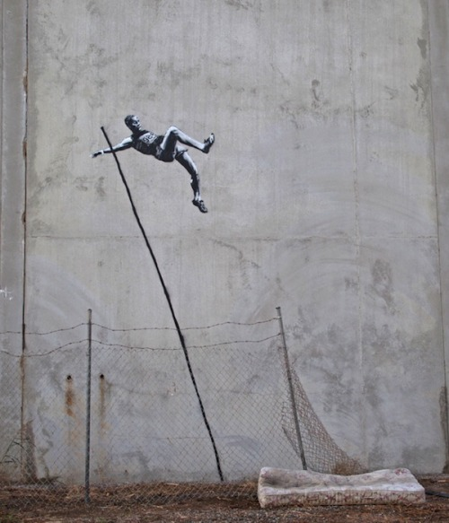 Banksy joins other U.K. street artists in putting up Olympics-themed works on the streets of London with two new murals.