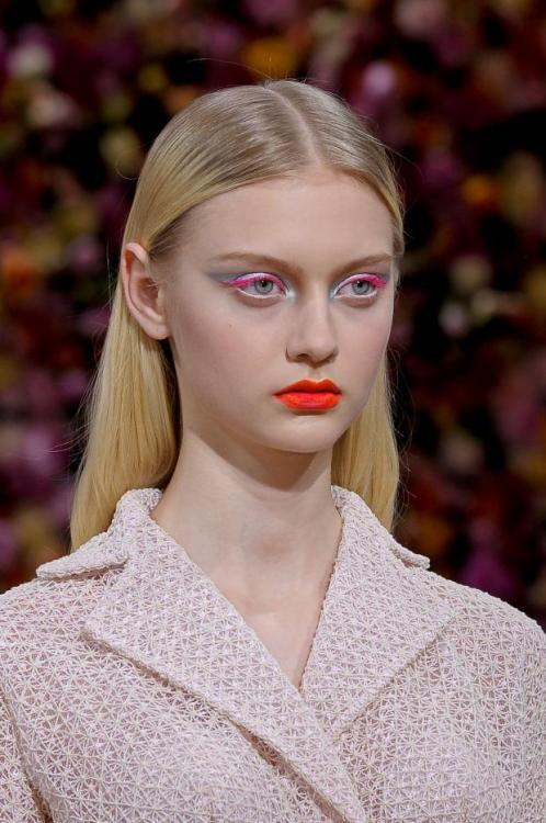 Christian Dior Haute Couture Fall 2012 Beauty- I love how the hair is kept sleek and slicked back while the makeup consists of neon & metallics on the eye and a vibrant lip. The look is avant-garde, futuristic yet elegant. Beautiful!