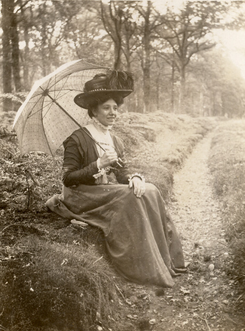 In the country with a parasol. Found image.