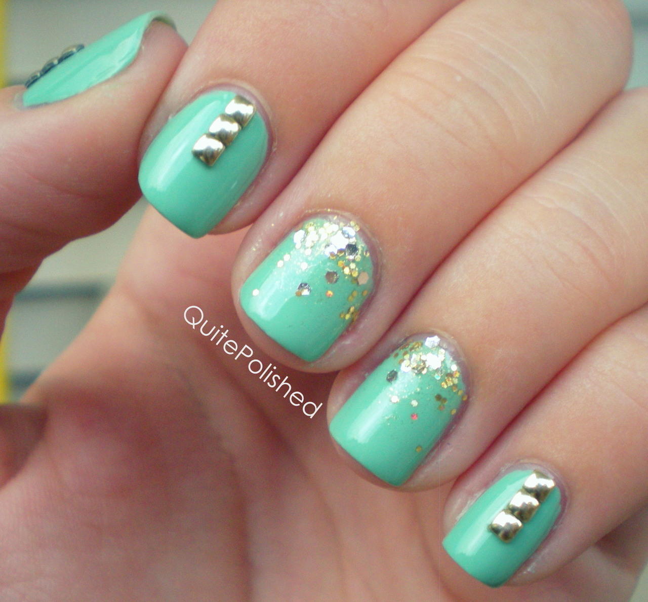 "meekz0411:   SUPER CUTE  quitepolished:  Oh hey der sexy badass nails. How you doin'? Okay I'm done. Maybe. Gosh I love these so much. This nail art features 2mm gold square studs from the Born Pretty Store.  When I first got into nail art the thought of attaching something to my nail and them not being completely smooth kind of freaked me out, but eventually I grew to love the way studs looked! I've been wanting my own for a while now so I was super excited to try these out! Born Pretty Store has square studs in two sizes (2mm and 4mm) and two colors (silver and gold). I wasn't quite sure how to apply these. I tried searching for directions but didn't really find any. The Born Pretty website says to apply your base color, place the studs on, then seal with a top coat. Because these were so tiny I knew I wouldn't be able to apply these to a wet surface and not smudge the polish. I decided to paint my base and apply a topcoat then wait for my nails to dry completely. I used tweezers to pick up the studs then with a toothpick I applied a tiny amount of nail glue to the back of the stud and placed it on my nail. I used the end of a bobby pin to do any adjustments because the round edge stood less of a chance dinging the polish. So I may have done it the ""wrong"" way but it worked for me. I chose nail glue over some sort of clear coat because I knew it would give me a more secure hold. The corners on these are slightly rounded so they wont snag, which is really nice. The base is Lex Cosmetics Cayman Caban and the gold glitter is Serum No. 5 Girl's Gotta Eat.  If you make a purchase from the Born Pretty Store you can use the coupon code UGJ61 for 7% off your entire purchase, plus they always ship free worldwide. :) *** The studs featured in this post were sent to me for an honest review. All opinions expressed in this post are my own."