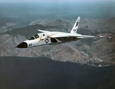 "North American RA-5C Vigilante.  ""A three-quarter port aerial view of an RA-5C (BuNo 156608) Vigilante aircraft, Reconnaissance Attack Squadron 7 (RVAH-7) known as the ""Peacemakers of the Fleet"" and was assigned to the USS Ranger (CV-61) and Carrier Air Wing Two (CVW-2) from February 21 to September 22, 1979. This photograph may show the Vigilante's last flight, since all Vigilante aircraft were officially retired in September 1979 and the RVAH-7 was officially decommissioned in October 1979. The exact date the photo was taken is unknown."""
