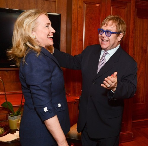 Secretary of State Hillary Clinton and Sir Elton John attend an event honoring them both hosted by The Human Rights Campaign, The Global Equity Fund and The Elton John AIDS Foundation at a private residence on July 23, 2012 in Washington, DC.