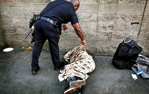 "thepeoplesrecord:  Los Angeles remains homelessness capital of the USJuly 24, 2012 Los Angeles is known for Hollywood and glamorous celebrities, but it is also a city where many live in poverty and suffer from hunger. Even if Southern California is home to several billionaires, the poverty rate in LA County is among the highest in the nation and the unemployment rate remains in the double digits, making Los Angeles the capital of glitz and homelessness. From exotic cars to extravagant fashion, the rich and famous give Los Angeles a reputation of opulent prosperity, but just around the corner from this glamour is the Los Angeles of utter despair. On Skid Row the homeless live in third world conditions and things they say are only getting worse. ""They feel like there is no hope for them. They're afraid of the police,"" said Mary Czrepuszko, a homeless Los Angeles resident. Los Angeles remains the homeless capital of the US with more than 51-thousand people living in shelters, cars or in homeless encampments. ""Staying in a shelter, getting bit every day. Having scars and scratching, it's really bad. I would rather just be on the street,"" said Czrepuszko, who became homeless after losing her job as a nursing assistant. While Mary Czrepuszko and her neighbors sleep on tattered blankets, just a short drive away are some of the wealthiest neighborhoods in America.  In this city of extremes, the celebrities and the super-rich enjoy pampered living on palatial, hillside mansions. Huge houses in exclusive neighborhoods give Los Angeles an image of glitz and glamour. Behind high security fences lay multi-million dollar homes with luxuries like Olympic size pools and a staff of maids.  The wealthiest rest safely behind their elegant walls, while some of the city's poorest face another long night next to a warehouse wall. A lavish mansion costing more than $50 million in Beverly Hills is unthinkable for most people in a city where 1 in 5 children live in poverty. ""It was 2 in the morning and me and my kids were sleeping on the bus stop. That was the first time we ever had to sleep on the bus stop,"" said Antoine Hudspedth, a Los Angeles homeless resident. After the real estate crash, Hudspeth lost his job as a mortgage loan officer and became disabled. Now he struggles to feed his wife and their three sets of twins. ""I don't want to see them sleeping on the streets. I can't have that,"" said Hudspeth. While Hudspeth and his family line-up for a sandwich, Los Angeles' wealthy dine in pricey gourmet restaurants and inside the massive dining rooms of their sprawling estates The startling gap between the haves and have-nots is seen in the growing number of families who cannot afford food and housing. ""We've had families who have stayed with us for over two years. Yes, that's sad, but we're still trying our best to give them the best we can give them and connect them with resources,"" said Kitty Davis Walker from Union Rescue Mission Los Angeles. As financial austerity looms, those resources are shrinking. It will be those in lines for the soup kitchens, not the grass fed beef and organic arugula, who will feel the pinch of California's belt tightening.  In this economic crisis, the rich in Los Angeles flaunt their high end lifestyle, while more families fall into poverty, making it likely the city will remain a place of fame and fortune but also of great financial anguish. SourcePhoto"