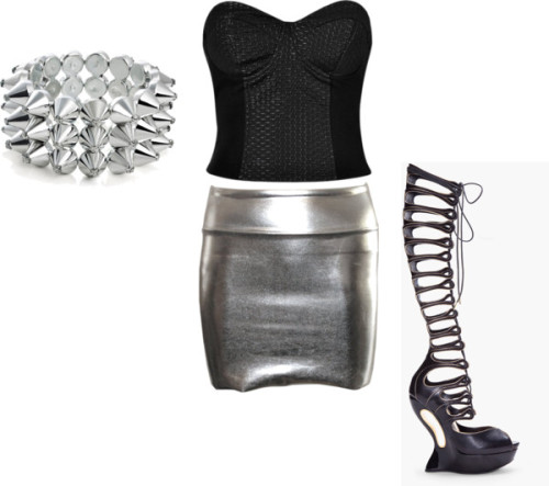 natkhatreha:  Hot.  Alexander McQueen black wedge / Silver jewelry