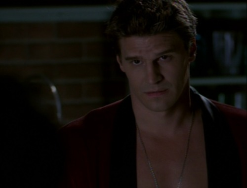 Angel gives Doyle a Look after Doyle accuses him of sleeping with Cordelia. (Angel, Season 1: Rm w/a Vu)