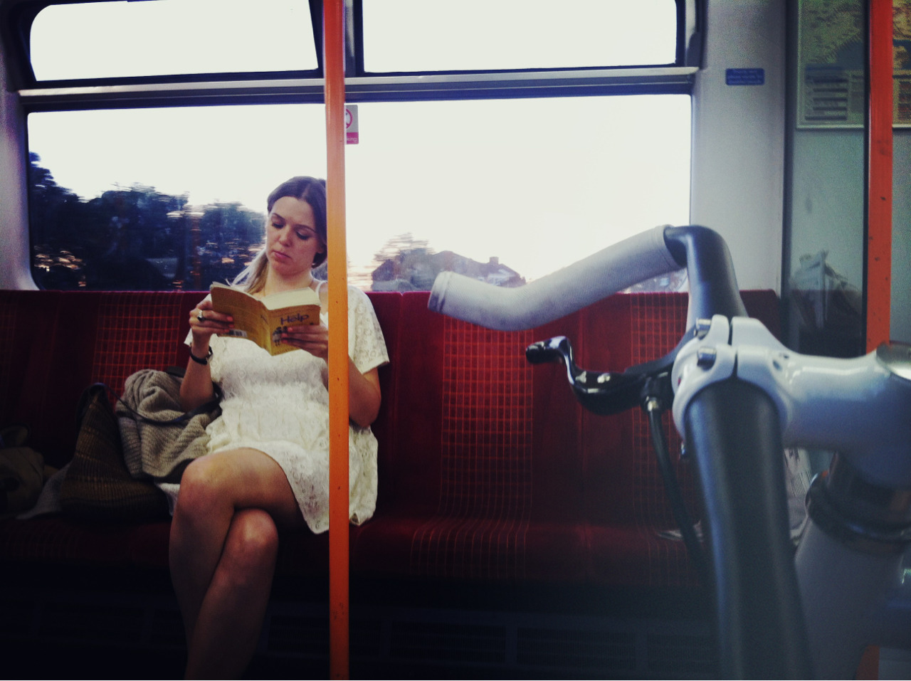 Sarah reading on the train.