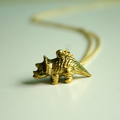 thatsprettyjewellery:  Triceratops Necklace This adorable little beauty maybe gloriously subtle but up close, he's so detailed that under a microscope, you'll be terrified he's real.  I want this necklace… reppin the triceratops!