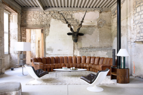 Michel Perry's home photographed by Jean-Francois Jaussaud The Endless Sofa by de Sede costs $50,0000.