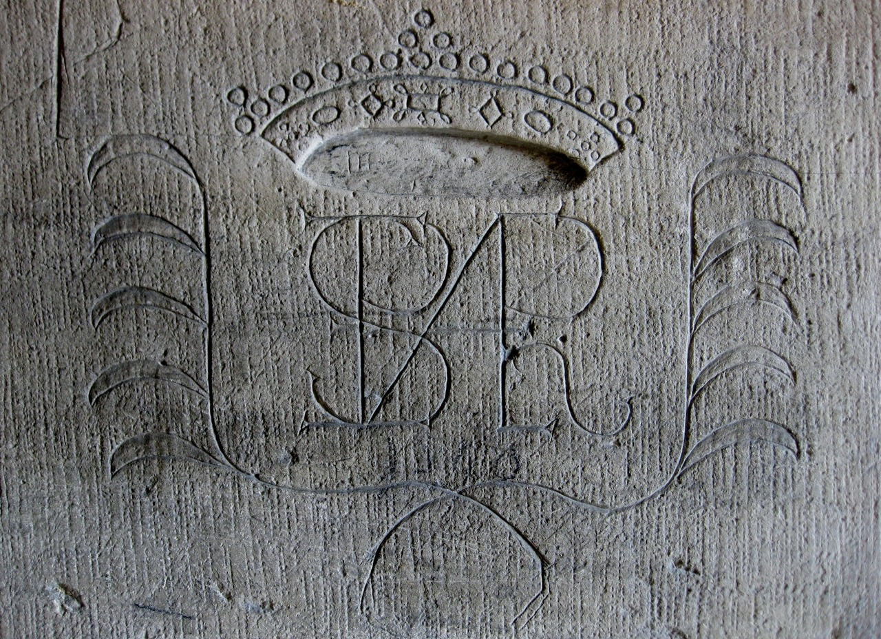 The monogram, perhaps, of a prisoner in the donjon of Chateau Vincennes. Vincennes was used as a state prison numerous times from the Middle Ages up to the German Occupation and the Liberation. Some of its famous occupants include the Marquis de Sade, Diderot and Mirabeau. Vincennes, France. Photo by Amber Maitrejean