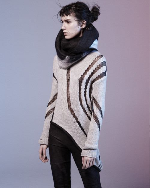 THE STATEMENT SWEATER. Strong hemlines and contrasting details combine to create Fall's key knits.
