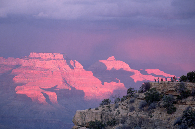 Visitors look out at pink rock formations on the South Rim of the Grand Canyon. A new study finds that seeing awe-inspiring sights can do a world of good for your mental health.