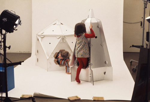 Roger Limbrick. Space Station and Space Rocket cardboard toys. 1968 In 1968 the British company Polypops developed three flat-packed cardboard spacecraft toys designed by Limbrick: Lunartrack, Space Station, and Space Rocket. When constructed, the Space Rocket is just large enough to accommodate one child passenger; its exterior is coated in foil and its interior is intricately printed with dials and circuits. Learn more at MoMA.org/centuryofthechild