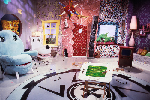 "Pee-wee's Playhouse interior. 1987 Pee-wee's Playhouse, the children's television show broadcast on CBS from 1986 to 1991, was modern and spectacular in every way. This quirky and ambitious Saturday-morning program was the only one of its time to incorporate live action with animation and puppetry. It was celebrated by critics and the popular press for its design elements (art direction, set design, costume design, graphics, and title design) as well as its original writing, music, and performances. The show's dense and lively format was complemented by flat, high-key lighting and the set itself, which was primarily the work of production designer Gary Panter with Wayne White and Ric Heitzman. The playhouse, like the narrative structure it housed, is best characterized as pastiche, and a cast of regular characters was created from everyday objects. Through its unique environment and rich episode content, the show enraptured young viewers while shaking up conventional ideas about domesticity, consumerism, friendship, and imagination. Paul Reubens (Pee-wee) intended it to be educational, entertaining, and artistic. ""I'm just trying to illustrate that it's okay to be different,"" he explained. ""Not that it's good, not that it's bad, but that it's all right. Tell kids to have a good time … be creative … question things."" Learn more at MoMA.org/centuryofthechild"