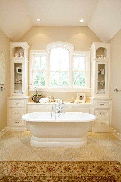 cream chic bathroom with a beautiful bathtub by Stonewood, LLC