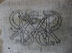 Prisoner graffiti in the donjon of Chateau Vincennes. Vincennes was used as a state prison numerous times from the Middle Ages up to the German Occupation and the Liberation. Some of its famous occupants include the Marquis de Sade, Diderot and Mirabeau. Vincennes, France. Photo by Amber Maitrejean
