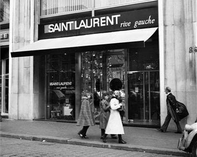 "whiskeysoaked:  1. Saint Laurent Paris Boutique, 1977 2.Hedi Slimane Comissioned Saint Laurent Paris Branding3. Saint Laurent Soho Boutique  4.2. Original YSL Logo by Adolphe Mouron Cassandre, 1961 Much like everyone else on the interwebs, I've been trying to figure out Hedi Slimane's decision to rebrand YSL as ""Saint Laurent Paris"" and if the move deserves the vitriol that has been thrown around over the last few days. My two cents? This isn't as much of a ""rebrand"" or ""departure"" but more of a ""retrobrand."" The iconic YSL logo was designed by Adolphe Mouron Cassandre and was the primary branding for the couturier for many years but that changed in 1966. At that point, the house debuted a ready-to-wear line (and was the first French house to do so) by the name of  ""Saint Laurent Rive Gauche."" The logo featured orange and pink squares and was created by Yves in collaboration with perfume designer Pierre Dinand.  While the new logo is a bigger jump than pulling the ""Rive Gauche"" logo from the archives, you can definitely see its influence in the blocky, sans serif font and Slimane's decision to only apply the rebrand to RTW. (via 1,2,3,4)   (via imgTumble)"