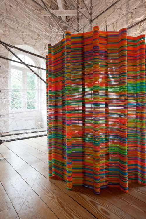 Likearchitects - chromatic screen installation made of 2,000 Ikea clothing hangers
