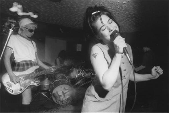 "25 YEARS OF GIRLS MISBEHAVIN' — BIKINI KILL LIVES ON 25 years later, Bikini Kill's influence hasn't vanished with the noonday tide. Cited as a major influence on many girl bands to follow, from Sleater-Kinney to The Gossip, Bikini Kill kicked down doors and smashed glass ceilings without apology. They just announced that they'll be starting their own ""Bikini Kill"" music label, which will be issuing re-releases of old Bikini Kill materials, and, we're sure, continued support for girls who just wanna rock out."
