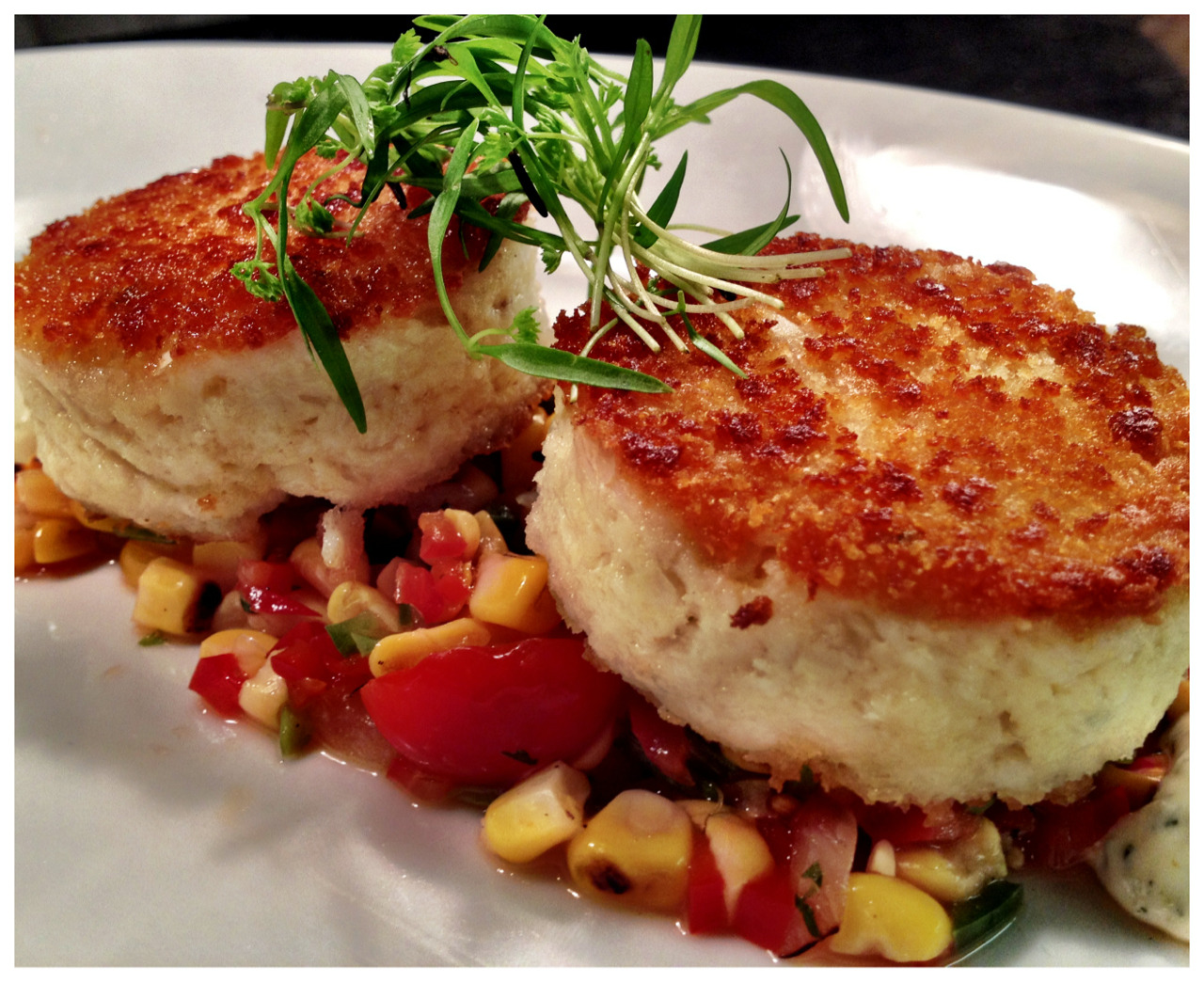 Who loves crab cakes? Here's our version served with grilled sweet corn, tomato salsa, cilantro for $15 (lunch menu).
