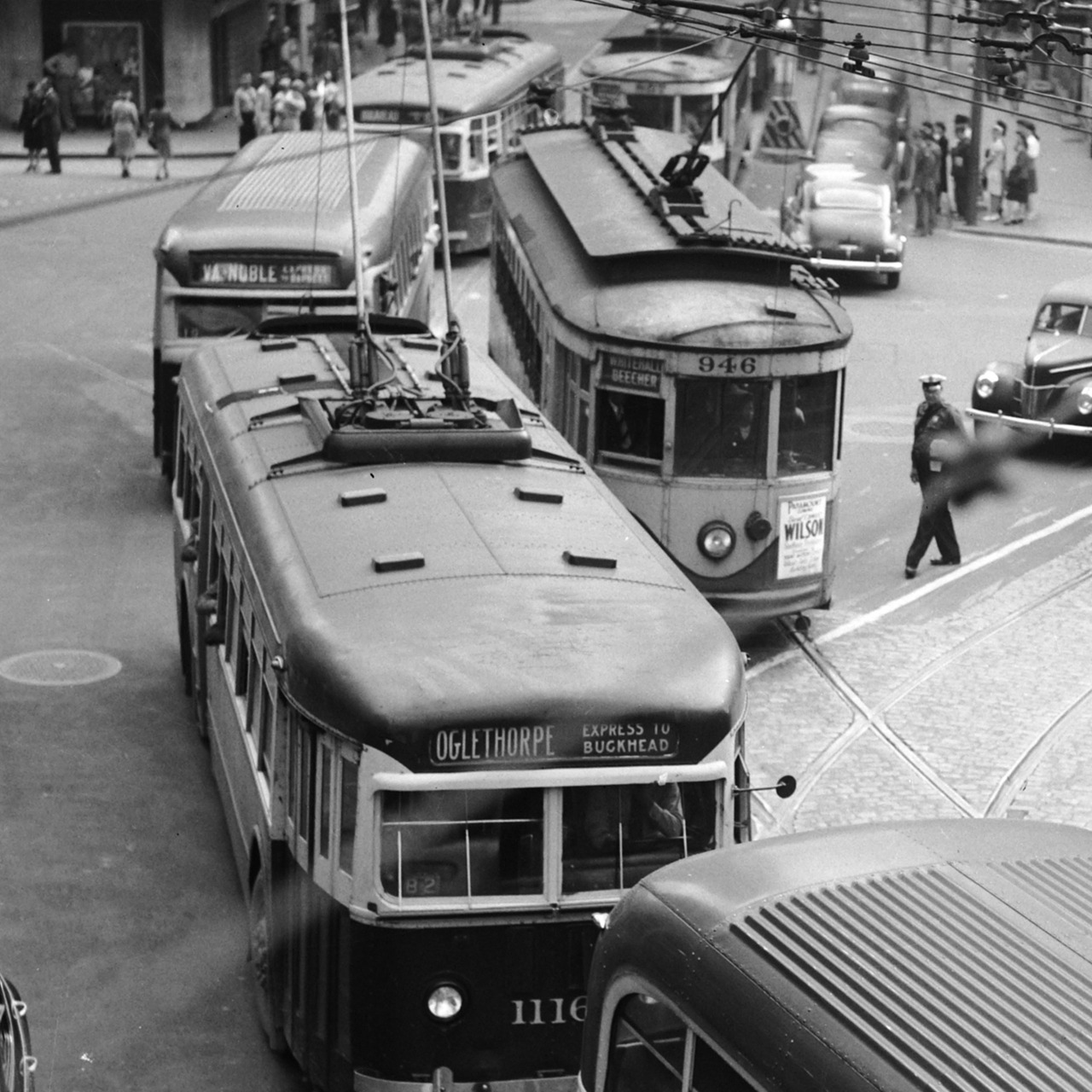 FROM THE ARCHIVES- 1945 view of trackless trolleys making their way down Peachtree Street.   Browse and order prints from our collection.