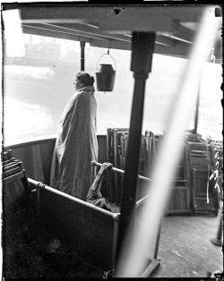 Female survivor of the Eastland disaster, wrapped in a blanket, standing on the upper deck of a boat on the Chicago River on July 24, 1915. Photograph from the Chicago Daily News.  Want a copy of this photo?  > Visit our Rights and Reproductions Department and give them this number: DN-0064947  Connect with the Museum