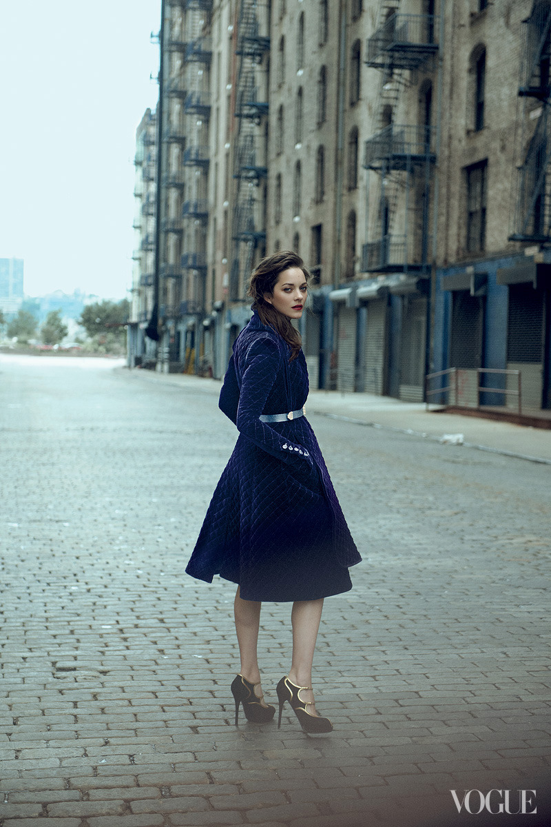 vogue:  Marion Cotillard in a Burberry Prorsum quilted velvet coat. Balmain belt. Ralph Lauren Collection heels. Photographed by Peter LindberghSee more photos on Vogue.com