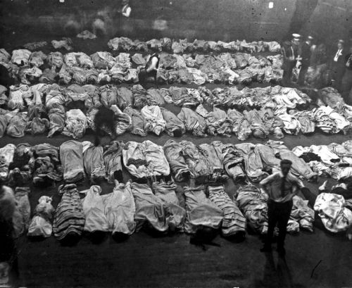 Lines of bodies in 2nd Regiment Armory converted into a post disaster morgue after the Eastland Disaster on July 24, 1915. Photograph by Jun Fujita.  Want a copy of this photo?  > Visit our Rights and Reproductions Department and give them this number: i33125 Connect with the Museum