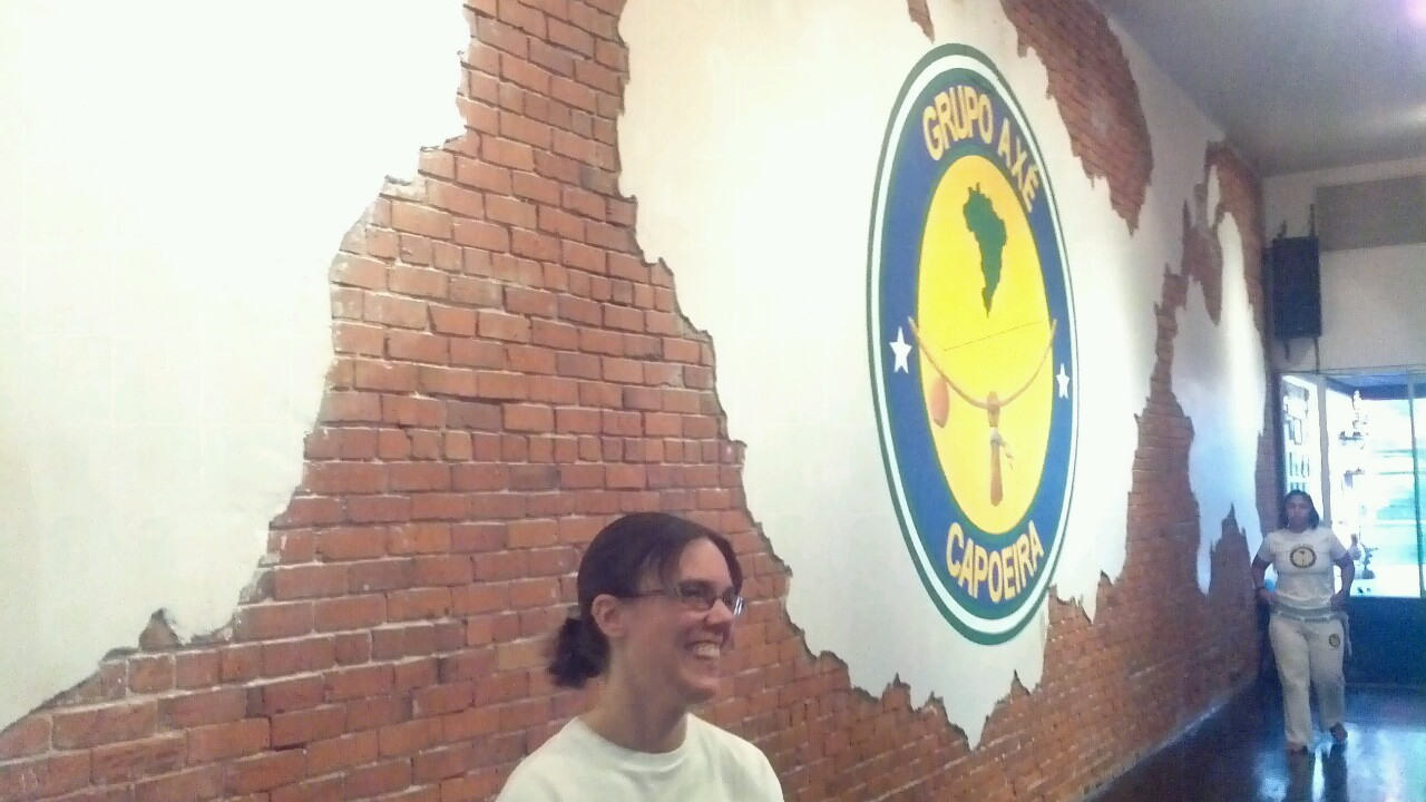 The north wall of the academy complete with smiling capoeirista.