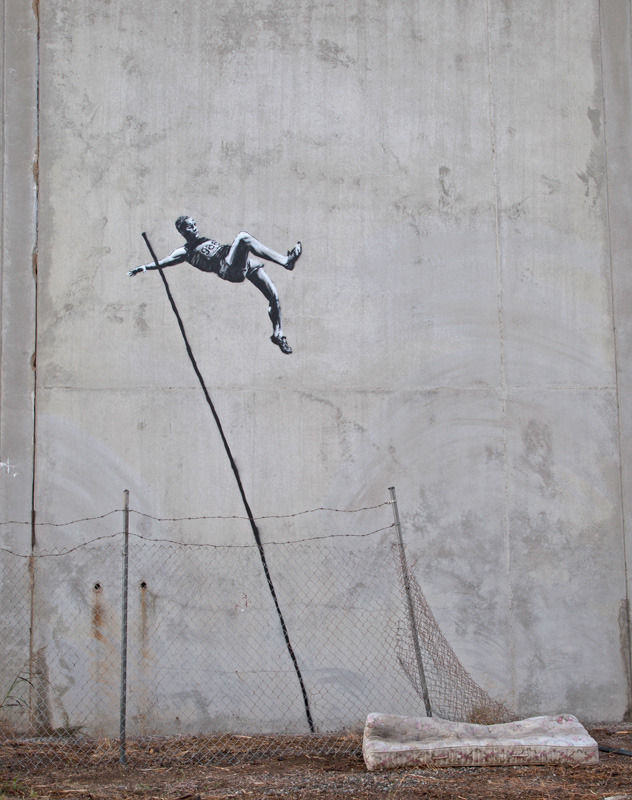 "Banksy Dares London Police Pre-Olympics By Jauretsi London has officially given the grand announcement to graffiti heads — no more tagging the streets. The message was heard clear with arrests of graffiti artists last week and the banning of street artists from Olympics venues. The Atlantic reports that Banksy has risen up as the leader of rebels painting 2 new pieces related to the Olympics. The controversy is that his work has become historical treasures. In 2007 Bristol Street cleaners painted over original Banksy work, and the city slapped them on the wrist, since the young artist murals increase property value on any block he hits worldwide. Although his original works are… [MORE] the type of pieces found at real art auction houses, we discovered some reprints available on eBay, including the classic Graffiti Balloon Girl, 24""x36"" on Canvas Print for $29.99.  Above is the new pole-vaulter image that sprung up on a London street this Monday. It has become quite a test and face off for the police… another wink at testing authority, his usual trademark. The whole world is watching now. Check mate."
