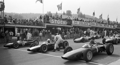 ready to race … the grid getting ready for the start of the 1962 Belgian Grand Prix held at Francorchamps with pole sitter Graham Hill (BRM P57), Bruce McLaren (Cooper-Climax T60) & Trevor Taylor (Lotus-Climax 24) on the front row