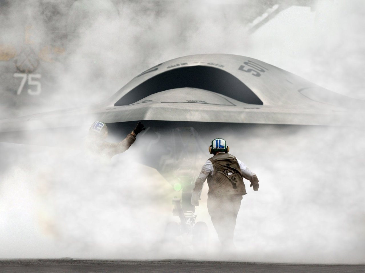 The US Navy prepairs the Northrop Grumman X-47B, an Unmanned Combat Air System (UCAS), for tests aboard the USS Harry S. Truman (CVN 75). The Navy is one year away from landing its first unmanned jet aircraft aboard a carrier after completing the most recent round of surrogate tests.
