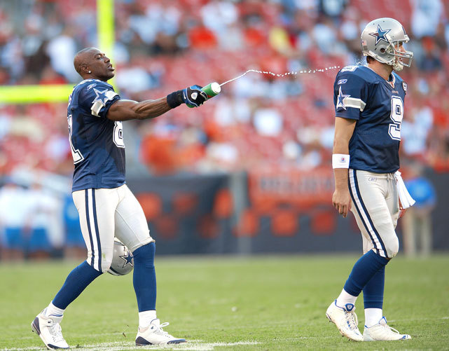 Cowboys receiver Terrell Owens sprays quarterback Tony Romo with water after a game against Cleveland. The two had a big day as Romo threw for 320 yards and Owens had five catches for 87 yards and a touchdown. (Al Tielemans/SI) GALLERY: Rare Photos of Terrell Owens | Tony Romo