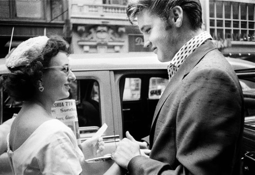 Elvis Presley with a fan photographed by Alfred Wertheimer, 1956