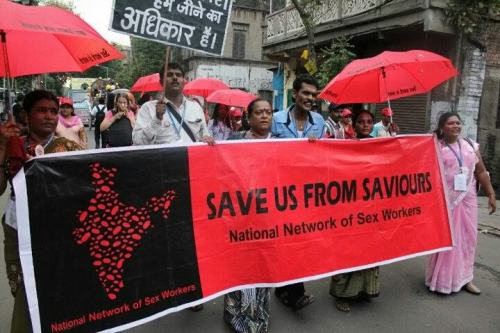 Sex workers from the National Network of Sex Workers in India march in Kolkata.