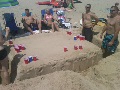 Beer Pong Table Made of Sand Mmmmmm, nothing goes together like beer and sand.