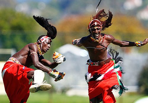 Kenya's Maasai Cricket Warriors bowler Jonathon Ole Mashami celebrates taking a wicket during a Last Man Standing Twenty20 match