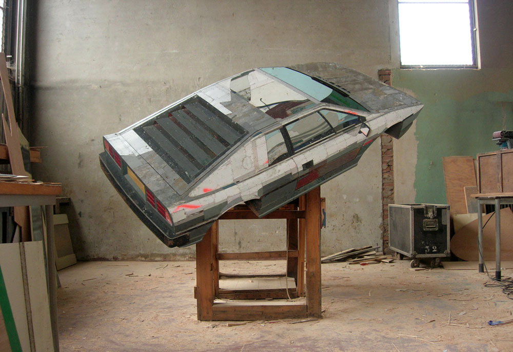 "Ron van der Ende, ""Silver Machine (Lotus Turbo Esprit 1983)"" Bas-relief in reclaimed timbers, 185 x 106 x 14cm  2007"